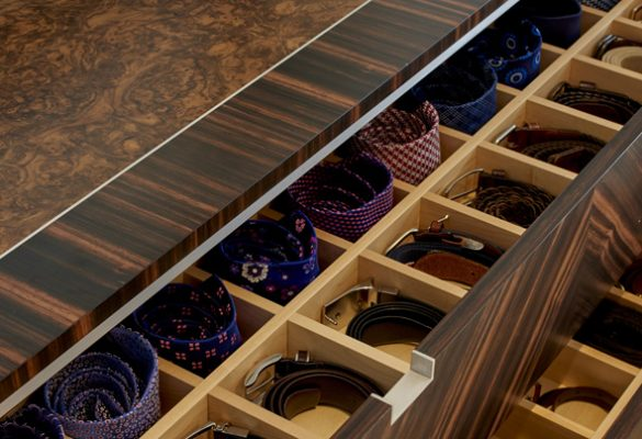 Macassar ebony in a quartered veneer pattern across the four drawers of this dressing unit.  Burr walnut top, hand sculpted legs in ebonised walnut and white metal detailing throughout.  The maple interior of this chest of drawers has been highly customised to store the couple's envious accessories collection.  Mirror in Macassar ebony.  Hand sculpted coat stand in solid walnut.  The piece is crafted using an intricate stack laminating technique which creates a visually striking layered effect when sculpted.  The piece is hand finished with natural oil resulting in a sensuous and tactile surface finish.